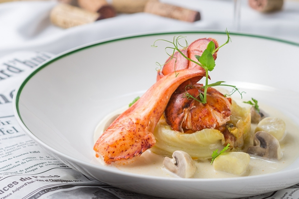 Butter poached Boston lobster on slow cooked savoy cabbage fish quenelle with mushroom cream sauce
