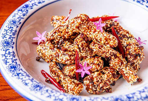 Crispy beef with dried chilli, cumin and sesame seeds